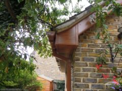 UPVC oak Tongue and groove soffit with square guttering box end detail