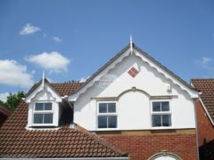 White concave decorative fascia with GRP roof spires