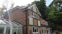 hite fascia and soffits with black deep flow guttering on detached character property