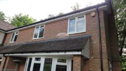 White fascias and soffits with deep flow black UPVC guttering