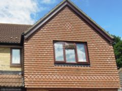 Replace bargeboards in rosewood UPVC