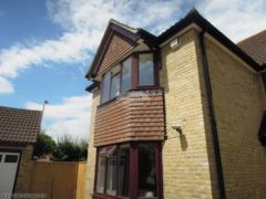 Rosewood fascia white soffit black square guttering replacement