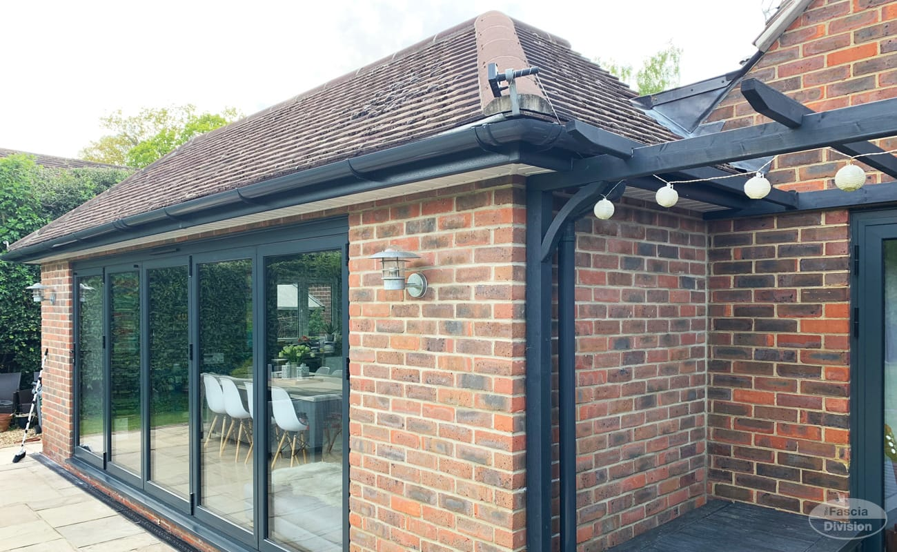 Grey fascia and guttering, white soffit installation