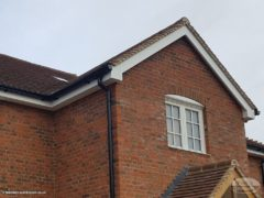 white UPVC bargeboards with black PVC guttering